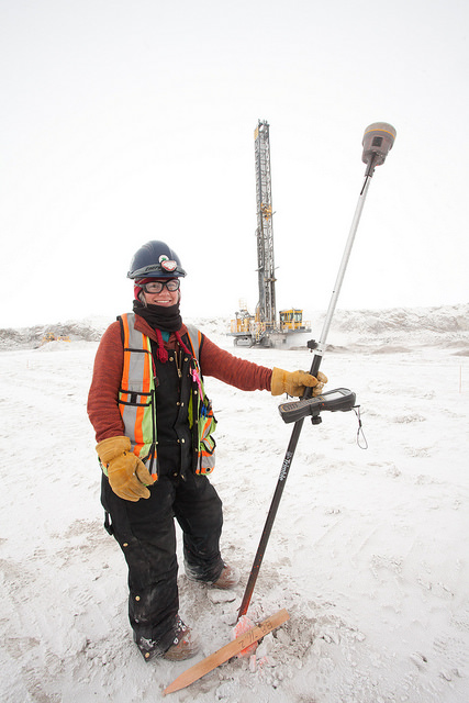 Nikki Laird, senior survey techologist for De Beers, stakes out drill blast holes.