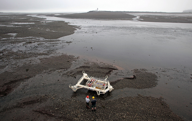 The Fundy Advanced Sensor Technology monitoring platform is being prepared  for sea trials during low tide in the Parrsboro Harbour, Minas Passage.