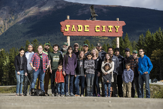 The citizens of Jade City, B.C.. standing under the sign of Jade City.