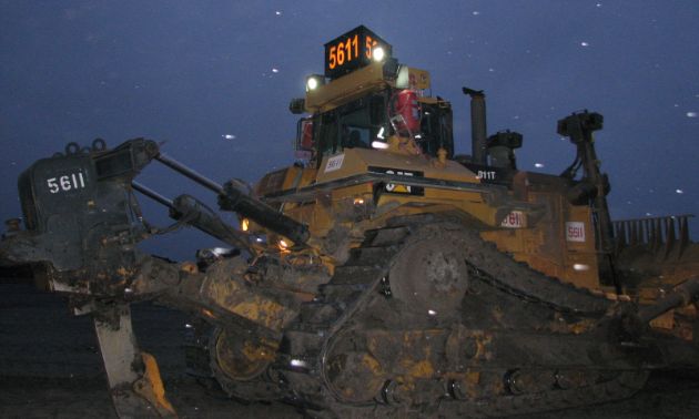Ralph's Radio Ltd. makes 26-inch three-sided signs for the top of graders and dozers.