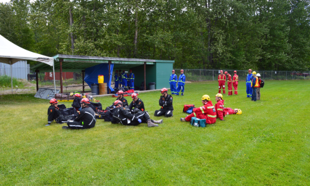 A group of miners rests between activities at the 62nd Mine Rescue and First Aid Competition