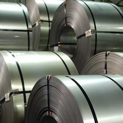 Large coils of rolled-up steel.