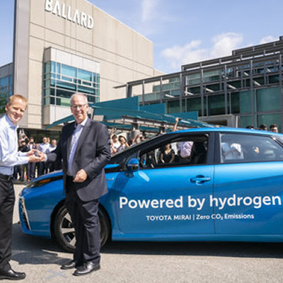 Stephen Beatty (right), Vice President, Corporate, Toyota Canada Inc. provides Randy MacEwen, President and CEO of Ballard Power Systems with keys to a new fuel cell Toyota Mirai.
