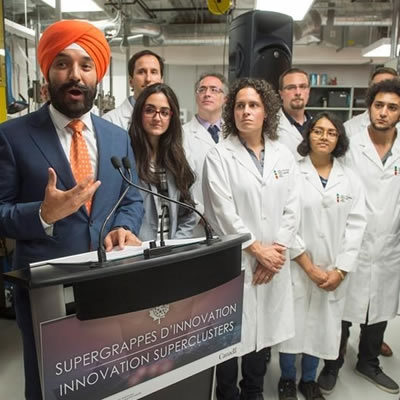 Federal Minister Navdeep Bains discussing the supercluster program at a news conference.
