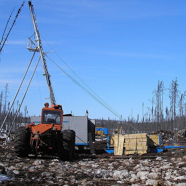 A tractor with a drilling rig is set up at the West McArthur site in 2012.