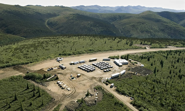 Aerial view of the Casino Project in Canada's Yukon Territory, showing camp and roads surrounded by trees and distant mountains.