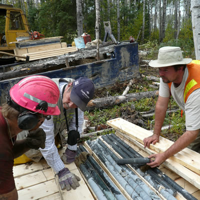 Workers examine core samples at the Sollas Lake Property.