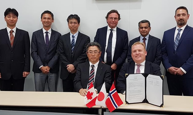 Below Seated: KHI Managing Executive Officer, Takeshi Ohata; and Corvus Energy CEO, Geir Bjørkeli. Standing left to right: KHI—Tatsuya Onodera, Technical Manager; Tatsuya Ohno, Technical Manager; Takenori Hino, Senior Manager; Corvus— Per Erik Schumann-Olsen, Executive Advisor; Pradeep Datar, VP Sales – Asia; Sean Puchalski, EVP Strategy & Business Planning.