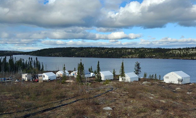View of small mining camp, overlooking lake.