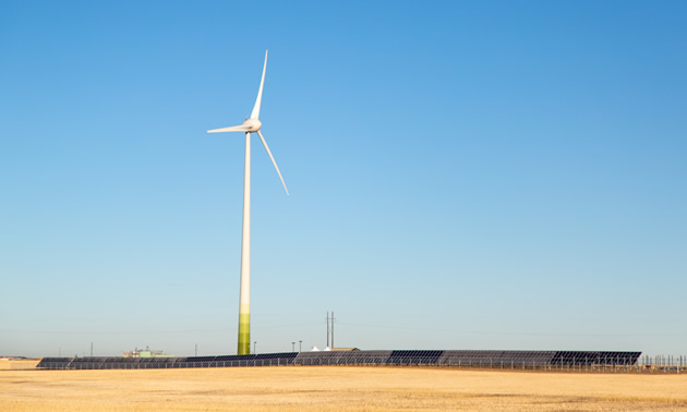 A wind turbine against a blue sky is part of Phase 1 of the Cowessess Renewable Energy Storage Facility.