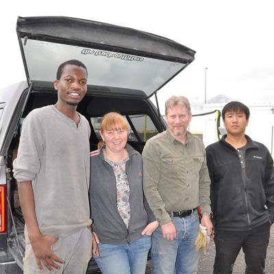 The fossils required a team effort to move. (L-R) Papa Sylla, Alison Seward, Shane Seward, Zhen Luo.