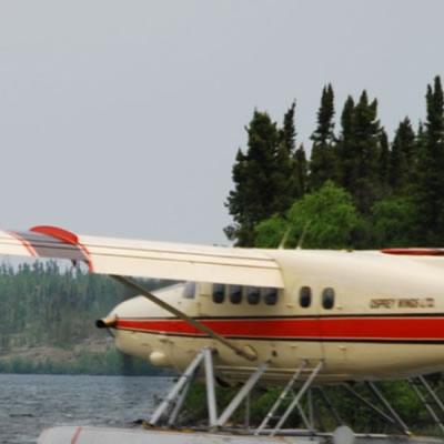Floatplane taking off from water.