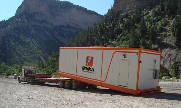 Combo unit offloading Filterboxx Modular Unit at a 303-man camp.