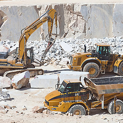Picture of heavy equipment working in rock quarry.