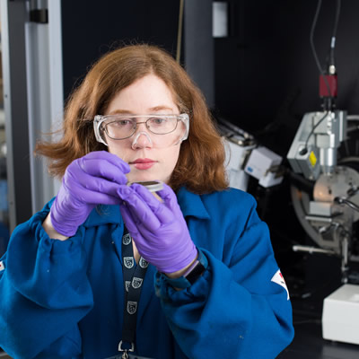 Heather's team works with companies in the oil and gas industry to find solutions to their sustainability challenges. She is shown here in the lab.