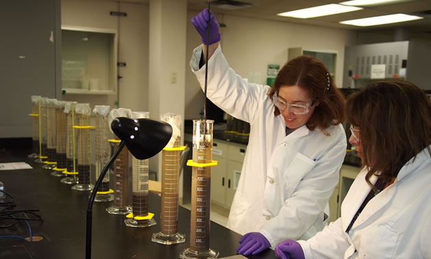 Heather Kaminsky is working in the lab at NAIT.