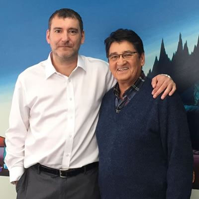 Jamie Saulnier and former National Chief Ovide Mercredi, Running Deer Resources advisory board member, are standing together.
