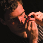 Photo of Jeff Nechka man studies a gem with a special magnifying glass