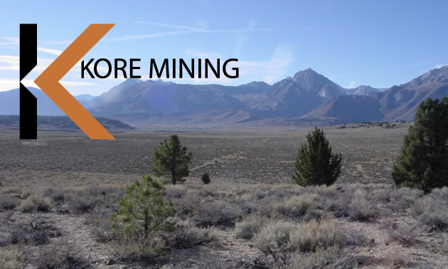 KORE Mining logo and picture of arid valley.