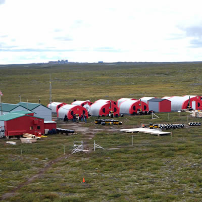Aerial view of Kennady Diamond camp, showing red buildings with grassland vista.