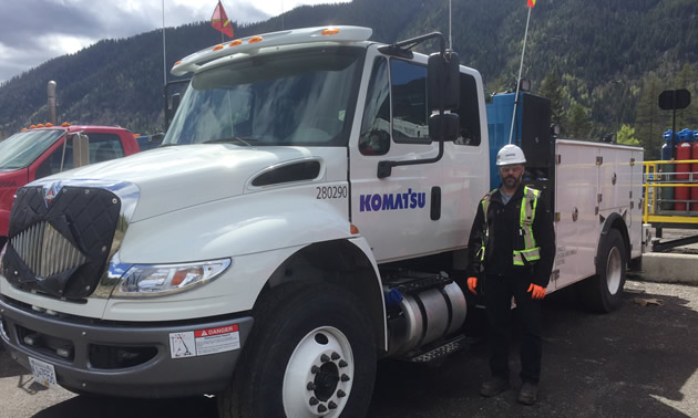 Steven Droste, Komatsu's Regional Manager – Western Canada, stands with one of the company's service vehicles.