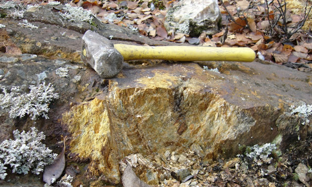 Picture of mining hammer and broken rock.