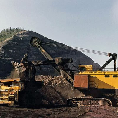 Picture of heavy machinery at a mine site.