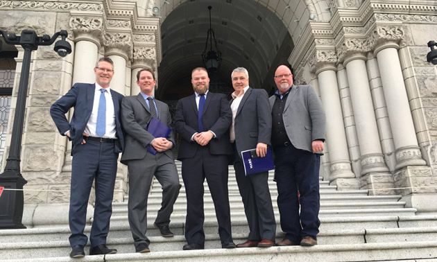 Pictured is one of 10 teams for Mining Day, standing in front of the legislature. Left to right: AME president and CEO, Gavin Dirom; Kal Tire regional sales manager, Kevin Frame; MSABC president and CEO, Alec Morrison; Wajax director of mining, Todd Sams; and general manager of Conuma Coal Resources, Al Kangas.