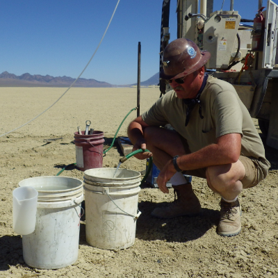 Nevada Exploration Inc.'s COO, Ken Tullar, collecting a groundwater from a direct push sample location.