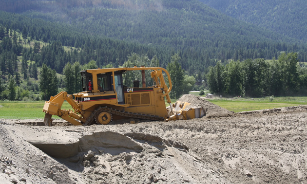 a bulldozer moving soil
