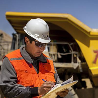 Teck worker looking at paperwork.