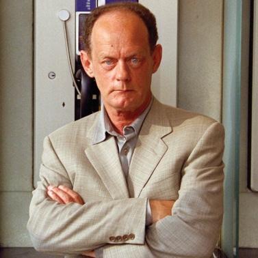 A photo of an unsmiling Rex Murphy.