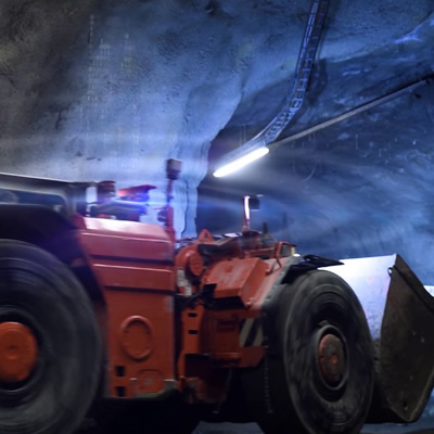 Sandvik Mining equipment in an underground tunnel.
