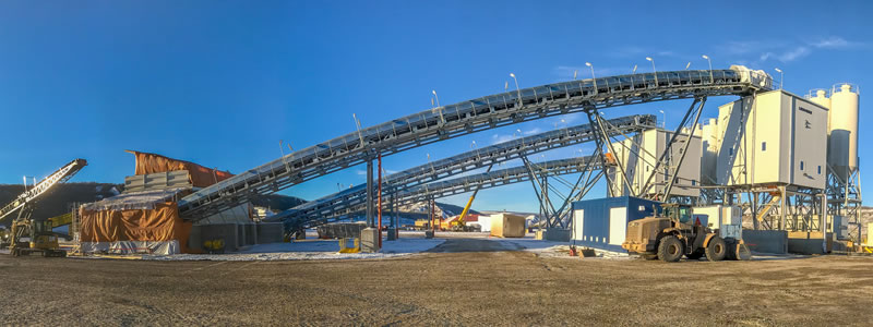 A picture of heavy construction equipment and structures at Site C dam.