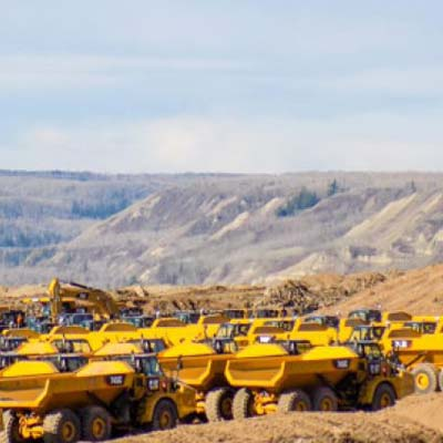Picture of group of large yellow trucks