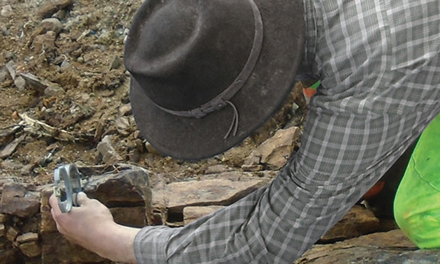 Worker studying rock samples.