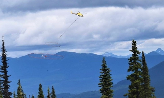 Aerial survey of project, showing helicopter.