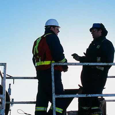 Picture of two workers having a conversation.