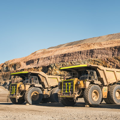 Line up of large mining trucks.
