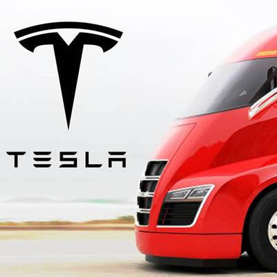 Picture of newly unveiled Tesla electric truck, red in colour, with Tesla logo.