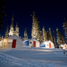 A camp with tents during a cold winter night.
