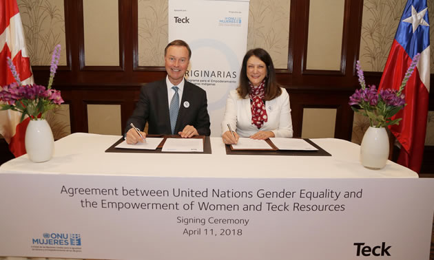 Don Lindsay, President and CEO, Teck, and Luiza Carvalho, UN Women Regional Director for the Americas and the Caribbean, sign an agreement.