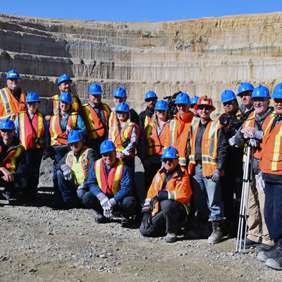 Guests pause during a tour of the Victor Mine pit for a photograph. The pit was one of several stops along the tour including the Process Plant, Reclamation areas, and more.