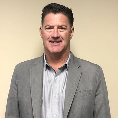 A headshot of Watson Gloves CEO Martin Moore.