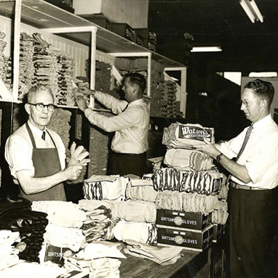An old photo of men working at Watson Gloves, which is celebrating 100 years as a Canadian company.
