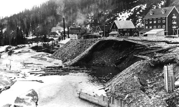 black and white photo of a caved-in mine entrance