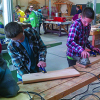 Photo of grade 9 students testing their skills in College of the Rockies' carpentry shop.