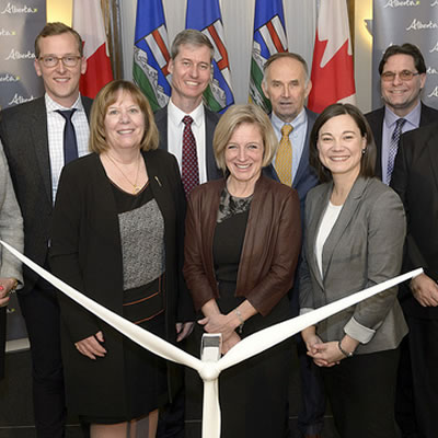 L-R: Megan Zimmerman (CED), Ryan Brown (EDP Renewables), Mike Law (Alberta Electric System Operator), Pascal Brun (Enel Green Power) Robert Hornung (CanWea), and Brian Vaasjo (Capital Power) with Minister McCuaig-Boyd, Premier Notley and Minister Phillips.
