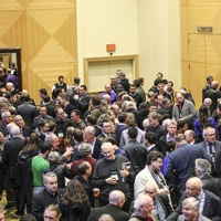 A crowd networking at a past AME BC conference.