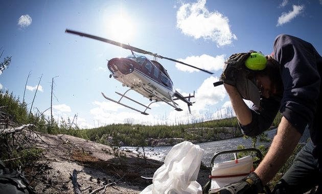 A helicopter picking up till samples.